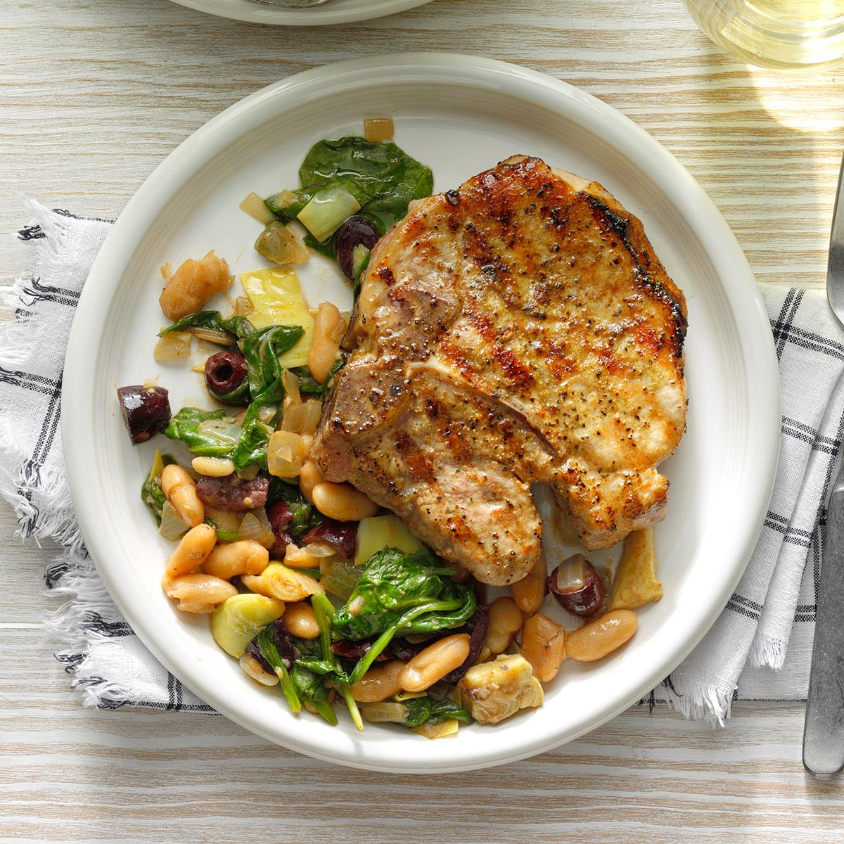 Dry-Rub Grilled Pork Chops over Cannellini Greens image