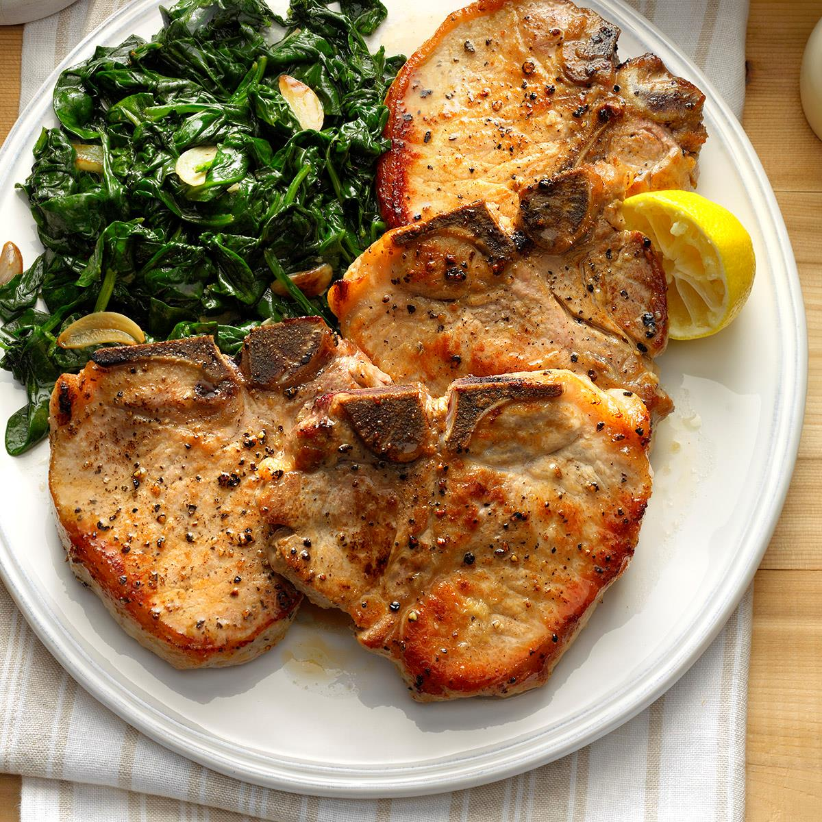 sauteed pork chops with garlic spinach recipe taste of home